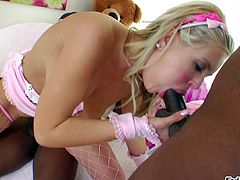 Andi Anderson is one nasty shaved pussy blonde in pink gloves and fishnet stockings. She gets her mouth and vagina drilled hard by two dark skinned men. She loves their big chocolate cocks.