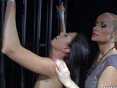 Naked helpless Sweet Claudia gets her sexy bare ass slapped by kinky mistress Katy Parker in the dark of the dungeon. Watch slave brunette with lovely butt get spanked by curious lesbian domme.