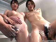 These two guys got in the bathroom to join two Japanese chicks who were having a soapy bathroom and fuck them hard in a foursome.