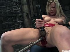 Press play on this breath taking scene where a smoking hot blonde's pleased beyond words by fucking machines while you hear her moan.