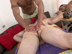 A gay couple is feeling very romantic so they go in for a massage together. The masseur is a bulky hunk and he knows just how to please them. He sucks both their cocks and then he gets sucked off himself.