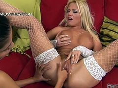 Sexy blonde chick Hajni B wearing cute white stockings is having fun with her lesbian GF. She lets her fist her snatch and can't help but moan loudly with pleasure.