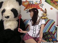 See a nasty brunette teen masturbating her shaved pussy with a naughty pink dildo while assuming very wild poses in front of her giant Panda bear.