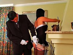 This hot like hell and slim brunette is fed up with cleaning the luxury house. This bitchie maid in short dress and stockings seduces unfaithful husband and squats down for giving a stout blowjob to his fat dick right near the fireplace.