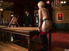 This submissive sluts are getting tied and lashed. Then they are forced to lick one another while getting fingered by their master in this BDSM video.