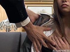 Slutty Japanese office girl Mako Higashio is having fun with some guy indoors. She kneels in front of him and sucks his dick reluctantly till the dude cums.