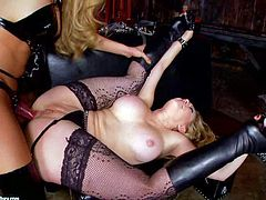 Big racked blonde Kagney Linn Karter with big melons and shaved pussy gets fucked by dominatrix Amy Brooke with strapon. Blonde in black stockings gets face fucked before she takes fake dick in her butthole.