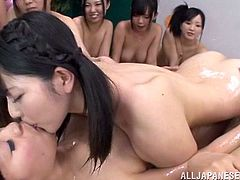 Japanese girls take their school uniform and have fun in inflatable pool. After some time they start to lick each others wet pussies.