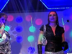Spoiled Russian milfs in steamy mini skirts get on the scene of a club during a wild corporate party to dance seductively in front of their colleagues.