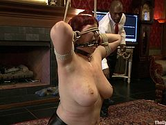 Get a load of this bondage clip where this busty redhead will give you a boner as you take a look at her big natural tits while she's tortured.