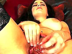 Turned on brunette stunner Taylor Vixen with french manicure and gigantic juicy hooters in stockings and black undies teases with delicious ass and stuff her honey pot with glass dildo.
