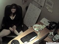 Get a load of this hidden camera video where a horny brunette gets a bit carried away in the office and is filmed while masturbating.