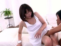 Insatiable dude hooks up with a zesty Japanese milf. He takes off her clothes and lingerie freeing her hairy pussy for a tongue fuck.