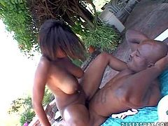 Attractive heavy chested ebony babe with pretty face and bog bouncing ass takes off white undies and gets banged hard by her black bull with muscled body in his backyard