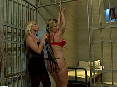 Rope bound prisoner Pamela in red lingerie gets her nice ass spanked with no mercy by blonde domina Kathia Nobili behind the bars. Watch juicy ass lesbian prisoner get punished.