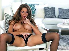 Beauty babe Emily Addison is licking her fingers
