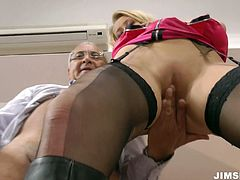 Appetizing light haired floozy in sexy black stockings Teena Dolly works with her mouth on huge dick and takes it up her wet snapper doggystyle.