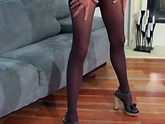Mov of Spicy female masturbing through her stockings