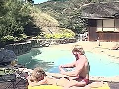 Married pair nail near pool