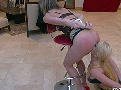 Round assed Ariel X with hands behind her back gets her perfect bottom used by curvy big meloned lesbian Sophie Dee in the middle of the room. Watch hot-ass girl get used by busty blonde.