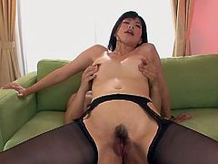 Taking everything off but her thigh high stockings and garter belt, Saki Aoyama is getting fucked hard in this asian xxx video and making those big tits bounce. She rides him and then lays down to feel him shoot his cum inside of her and creampie her pussy.