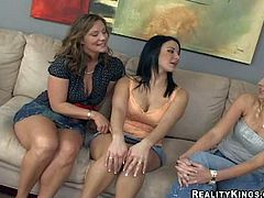 Kristen Cameron, Brianna Ray and Kenna get together to have fun. Black haired sexy milf with bra busting tits spreads her long legs and gets fondled by two ladies on the couch. Watch three women play together.