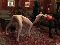Have a look at this bondage scene where slutty babes are tortured and forced to play with one another to their master's will.