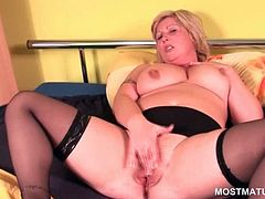 Chubby blonde mature in stockings rubbing her pink wet pussy with lust