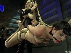 Watch this pretty brunette bitch get the full BDSM treatment. Everything from gagging, to getting tied up and even being forced to eat a strange pussy.