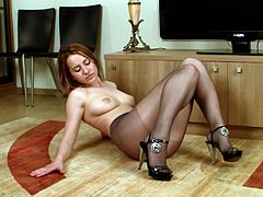 Slutty babe in black stockings enjoys solo masturbation that pleases her deep desires