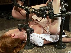 Amazing redhead chick gets her feet whipped. Later on she gets her hot pussy fingered and toyed with big dildo.