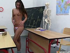 Staying in class after lessons, tasty looking brunette teen gets totally naked before she sits on a desk and widens her legs to rub a tiny cunt with fingers.