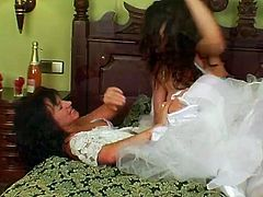 Two brunettes are in white bride gowns. Kinky chicks wanna get married. So two bitches are ready to fight for a chance to win a strong stud as a prize. Voracious nymphos moan while beating and pushing each other, pulling hair, grabbing necks and tits passionately.