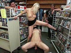 Lecherous blonde Lorelei Lee is having fun with a few men in a shop. She lets them finger her holes and then enjoys their hard schlongs in her cunt.