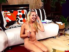 Slender young blonde slut Ashley Stone with natural boobies and long legs gets naked and licks her feet on the floor in provocative position in front of webcam for kinky customer.