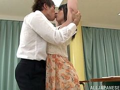 Naughty Japanese girl takes her clothes off in the classroom and kisses with a man. After that she gets fucked nice on the floor.