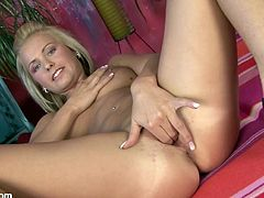 See this horny blonde taking off her bikini to play with her pink pussy in this solo scene where she'll give you one hell of a boner.