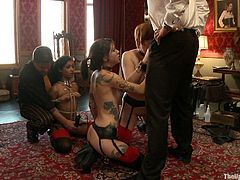 You're really going to like this bondage scene where submissive babes are tortured and forced to suck on her master's big cock in front of the camera.
