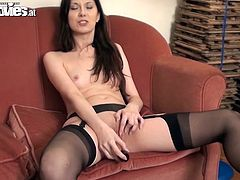 This hot brunette is called Sarah Dark and she's going to masturbate with a shiny dildo with her stockings on.
