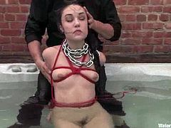 Famous Sasha shows her passion and love for submission. She gets tied up and toyed with a vibrator. After that the guy whips her ass and puts in Jacuzzi.