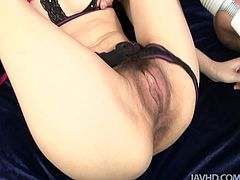 She spread her legs wide to get her succulent pussy stimulated with vibrator and after that fingered hard by two horny guys.