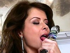 Gorgeous brunette beauty Emily Addison is shoving her favorite dildo toy inside of her awesome tight cunt, while being home by herself and when nobody is seeing it.
