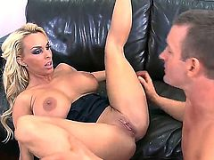 Seductive smoking hot blonde milf Holly Halston with huge fake balloons and long legs gets her shaved twat licked and banged hard to orgasm by young horny stud Tj Cummings.