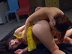 Hot Japanese lesbians Yuka Ohsawa and Yuu Kawakami are having some good time together. They kiss and pet each other and then use a double dildo to satisfy each other.