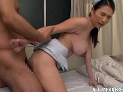 Slim Japanese chick takes her nurse uniform off and gives a blowjob. After that she lies down on a bed and gets her tight pussy pounded.