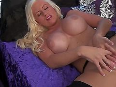 Hot and sexy blonde girl Chloe Dee lying on the bed in hotly exciting black stockings and naughtily masturbating and fingering her pussy