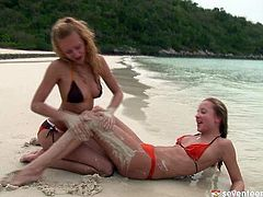Two mind taking blond babes in steamy tiny bikinis goof around at the beach rubbing over each other's steamy bodies. They continue caressing each other on the yacht in steamy lesbian sex video by Club Seventeen.