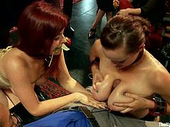 Two hot slave girls get tied up and toyed in their asses. After that the blonde one gives a titjob to her master.
