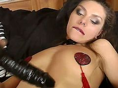 Wild whore Michell in super hot and sexy stockings has really little shaved pussy which she rubs hard with a big black dildo smoking a cigarette before she gets a real dick.