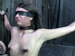Look at her, that worthless piece of ass. She's down on her knees, knowing her place and stays there with her hands tied and blindfolded. The bitch awaits humiliation and a big hard cock inside her mouth. She receives what she needs as the executor puts clamps with weights on her nipple and then mouth fucks her